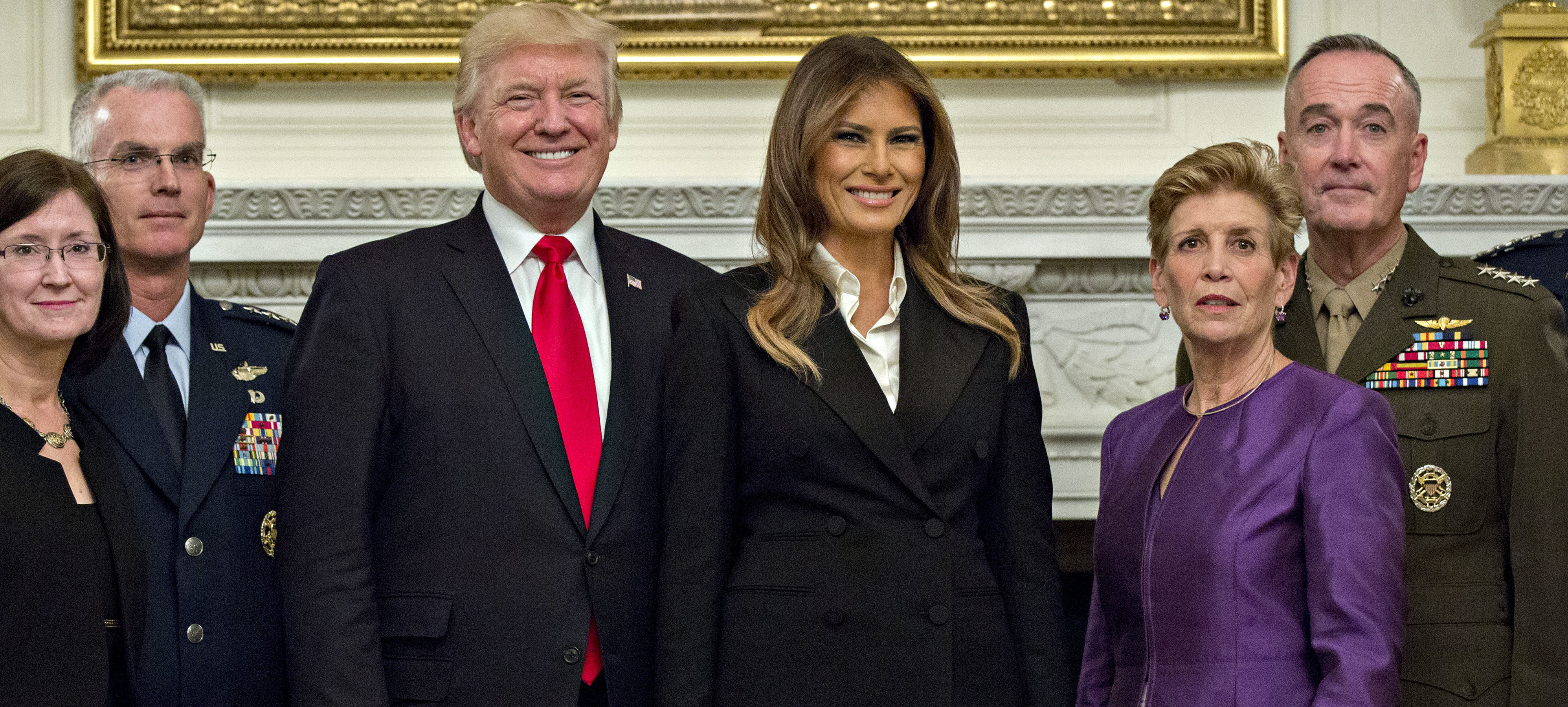 WASHINGTON, DC - OCTOBER 5:  U.S. President Donald Trump and first lady Melania Trump pose for pictures with senior military leaders and spouses, including including Gen. Joseph Dunford (R), chairman of the joint chiefs of staff, and General Paul Selva (2nd L), vice chairman of the joint chiefs of staff, after a briefing in the State Dining Room of the White House October 5, 2017 in Washington, D.C. The Trumps are hosting the group for a dinner in the Blue Room.  (Photo by Andrew Harrer-Pool/Getty Images)