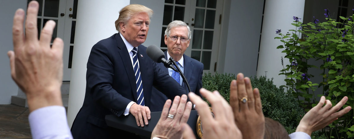 President Donald Trump (L) and Senate Majority Leader Mitch McConnell (R-KY) talk to reporters in the Rose Garden following a lunch meeting at the White House October 16, 2017 in Washington, DC. (Photo: Chip Somodevilla/Getty Images)
