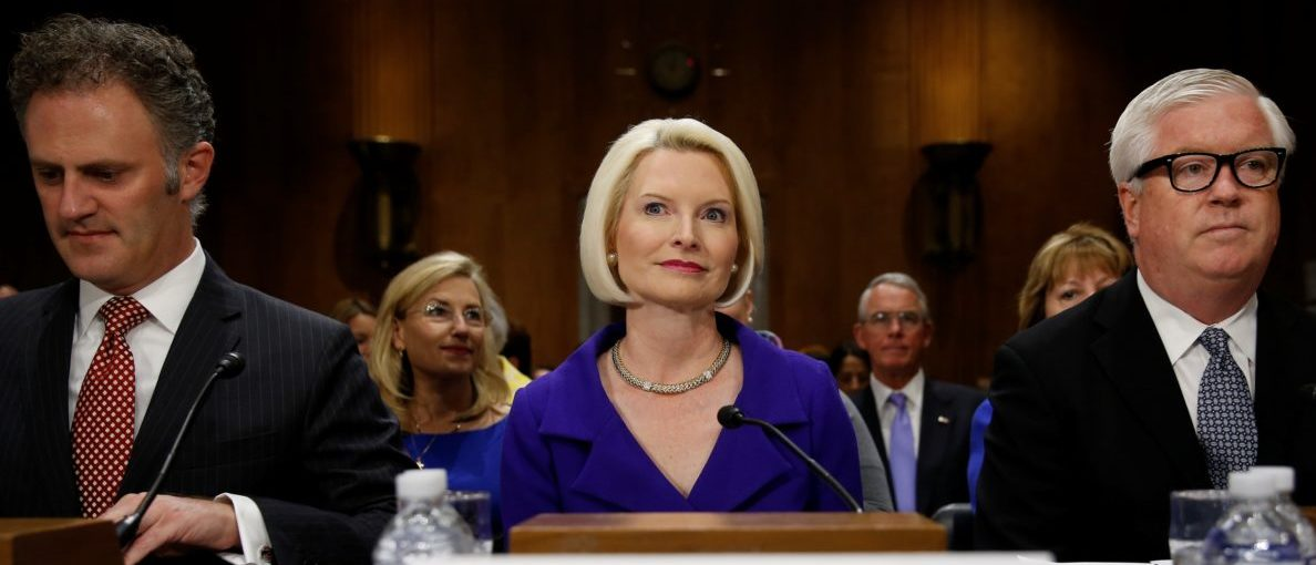 Callista Gingrich takes her seat for a U.S. Senate Foreign Relations Committee hearing to discuss in part her nomination as President Donald Trump's pick to be U.S. ambassador to the Vatican, on Capitol Hill in Washington, U.S. July 18, 2017. Also pictured are State Department counter-terrorism coordinator nominee Nathan Sales (L) and U.S. ambassador to Portugal nominee George Glass (R). REUTERS/Jonathan Ernst