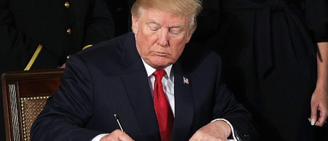 WASHINGTON, DC - OCTOBER 26: U.S. President Donald Trump signs a presidential memorandum during an event highlighting the opioid crisis in the U.S. October 26, 2017 in the East Room of the White House in Washington, DC. Trump plans to authorize the Department of Health and Human Services to declare a nationwide public health emergency in an effort to reduce the number of opioid overdose deaths across the nation. (Photo by Alex Wong/Getty Images)