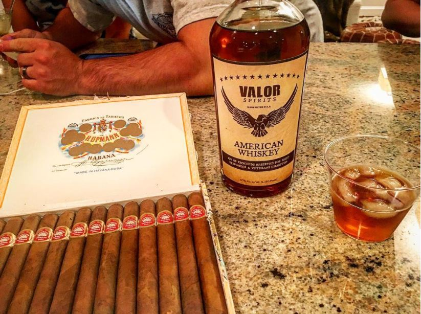 Valor and a box of cigars. Photo: courtesy of Valor Spirits.