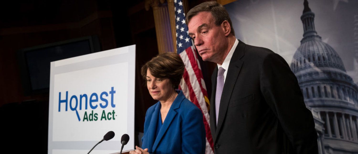 WASHINGTON, DC - OCTOBER 19: (L to R) Sen. Amy Klobuchar (D-MN) and Sen. Mark Warner (D-VA) take questions during a press conference to introduce the 'Honest Ads Act,' on Capitol Hill, October 19, 2017 in Washington, DC. The legislation is designed to increase the transparency of political ads on social media platforms like Twitter and Facebook. (Photo by Drew Angerer/Getty Images)
