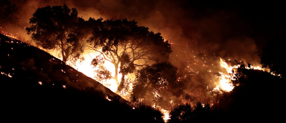 The Canyon Fire burns hillsides in Corona
