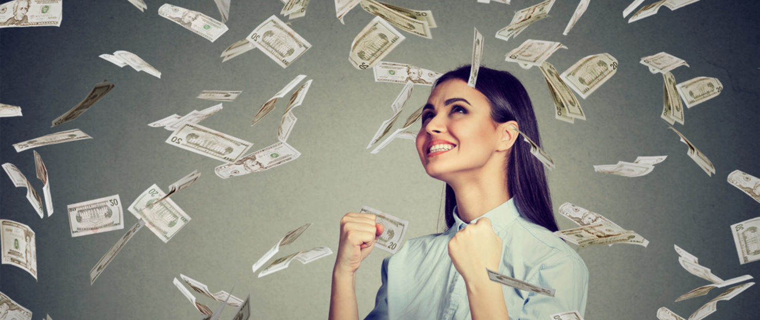 A woman celebrates her sudden wealth. (Shutterstock/pathdoc)