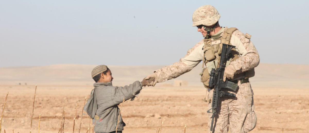 Staff Sgt. Cary Anderson, a team leader with Lima Company, 3rd Battalion, 25th Marine Regiment, greets an Afghan child in Habibabad during a joint patrol, Dec. 13. Marines and Danish soldiers, alongside their Afghan National Army counterparts met with locals during a joint patrol to establish relationships in the area. US Marines Flickr