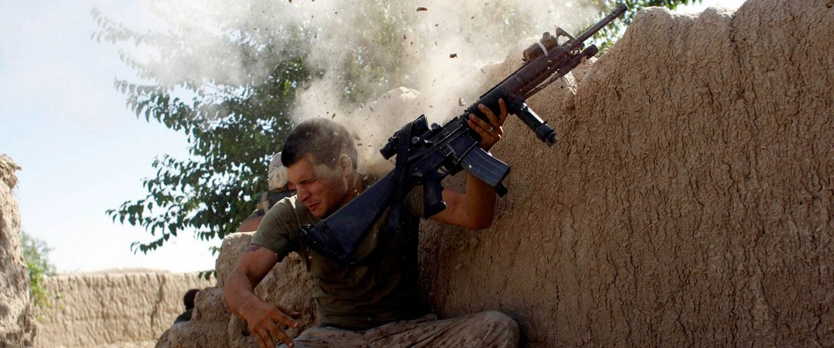 Sgt. William Olas Bee, a U.S. Marine from the 24th Marine Expeditionary Unit, has a close call after Taliban fighters opened fire near Garmser in Helmand Province of Afghanistan May in this 18, 2008 file photo. Goran Tomasevic: If I hadn't already been pointing the camera at the Marine when the bullet hit the wall, there is no way I would have been able to react quickly enough to take those pictures REUTERS/Goran Tomasevic.