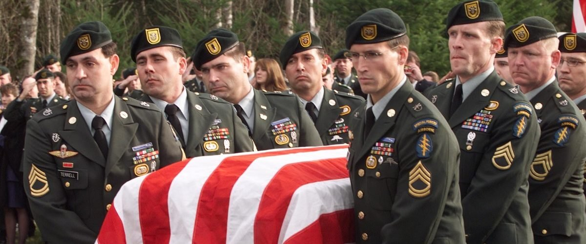 A detachment of 1st Special Forces Group Green Berets from Ft. Lewis, Washington carry the flag draped coffin of Sgt. 1st Class Nathan Chapman during burial services at Tahoma National Cemetery in Covington, Washington, January 11, 2002. Chapman was the first American killed by direct enemy fire in Afghanistan. (Anthony Bolante/Reuters)