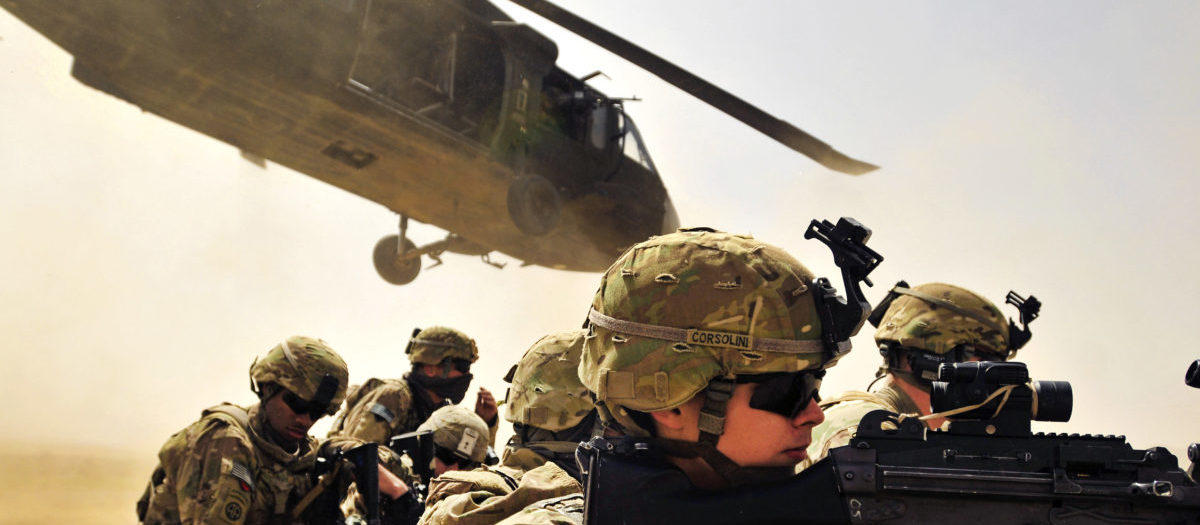 Pfc. Samuel Corsolini, a gunner assigned to F Company, 2nd Battalion, 25th Aviation Regiment, 25th Combat Aviation Brigade, pulls security with other Pathfinders as a UH-60 Black Hawk helicopter takes off after unloading his team and members of 2nd Afghan National Civil Order Patrol Special Weapons And Tactics Team during a vehicle interdiction as part of Operation Pranoo Verbena in order to disrupt Taliban operations in Kandahar province, Afghanistan, March 16. US Army/Flickr