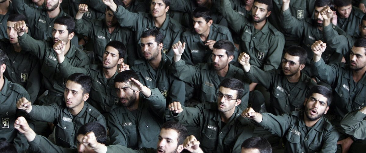 Iranian revolutionary guard corps chant slogans in support of Iran's nuclear programme during Friday prayers in Tehran May 26, 2006. REUTERS/Raheb Homavandi.