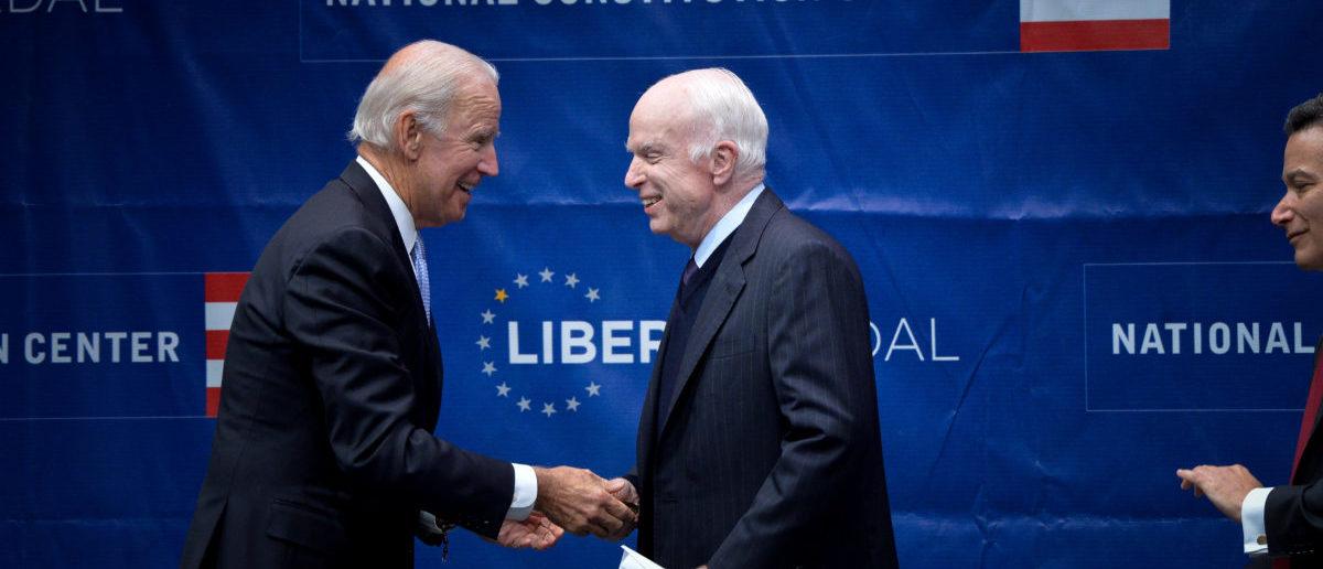 U.S. Senator John McCain (R-AZ) is awarded the 2017 Liberty Medal by former U.S. Vice President Joe Biden at the Independence Hall in Philadelphia, Pennsylvania, U.S., October 16, 2017. (REUTERS/Charles Mostoller)