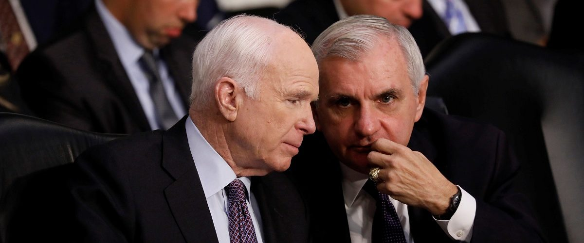 Sen. John McCain (R-AZ) confers with Sen. Jack Reed (D-RI) as General Joseph Dunford, Chairman of the Joint Chiefs of Staff, testifies before the Senate Armed Services Committee on Capitol Hill in Washington, U.S. September 26, 2017. REUTERS/Aaron P. Bernstein.