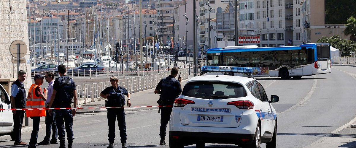 French police block the street after one person was killed and another injured after a vehicle crashed into two bus shelters, in Marseille, France, August 21, 2017.   REUTERS/Philippe Laurenson.