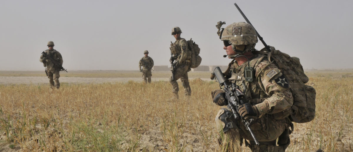 Spc. Jeremiah Carter, from Mooresville, Ind., with Bravo Company, 2nd Battalion, 23rd Infantry Regiment, conducts a dismounted presence patrol with his unit June 2, 2013 near Forward Operating Base Spin Boldak, Kandahar province, Afghanistan. The unit was patrolling to meet area farmers and project force posture. (U.S. Army photo by Staff Sgt. Shane Hamann, 102nd Mobile Public Affairs Detachment.)