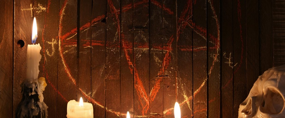 Here is a bloody pentagram on wood background. (Photo: Vera Petruk/Shutterstock)