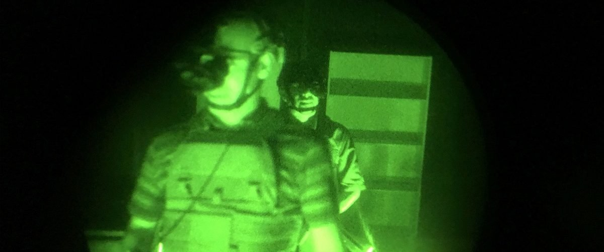 """Attendees perform tasks in the dark using military night vision technology at the History exhibit to promote the new television series """"Six"""", based on Navy SEAL Team Six, during CES in Las Vegas, Nevada, January 7, 2017. David McNew/AFP/Getty Images."""