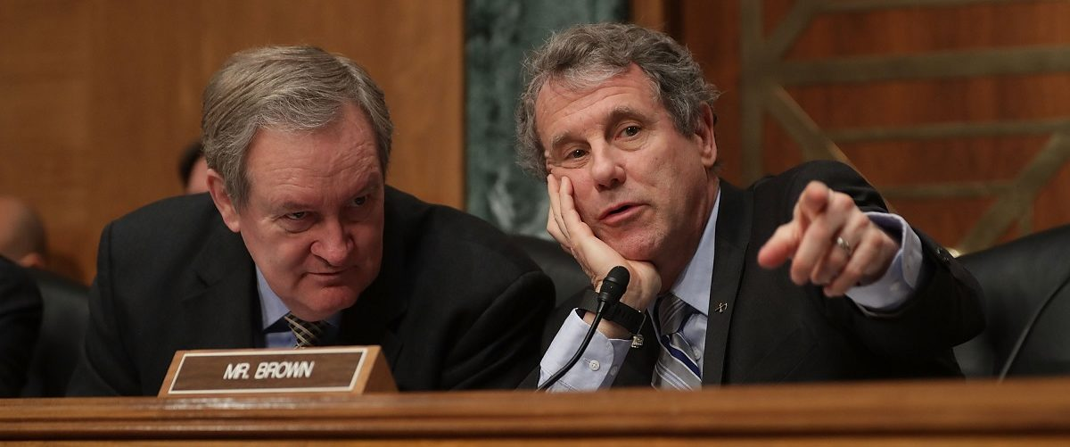 Senate Banking Committee Chairman Mike Crapo (R-ID) (L) and ranking member Sen. Sherrod Brown (D-OH) talk during the confirmation hearing for Jay Claton to be commissioner of the Securities and Exchange Commission in the Dirksen Senate Office Building on Capitol Hill March 23, 2017 in Washington, DC. Nominated by U.S. President Donald Trump to lead the SEC, Clayton was questioned by senators about his years representing large banks like Goldman Sachs, Barclays, Deutsche Bank and other Wall Street companies. Chip Somodevilla/Getty Images.