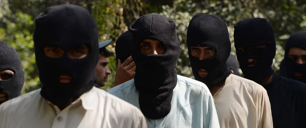 Afghan police said 10 alleged Islamic state fighters, including two non-Afghans, and four Taliban militants were arrested during an operation in Nangarhar province. Noorullah Shirzada/AFP/Getty Images.