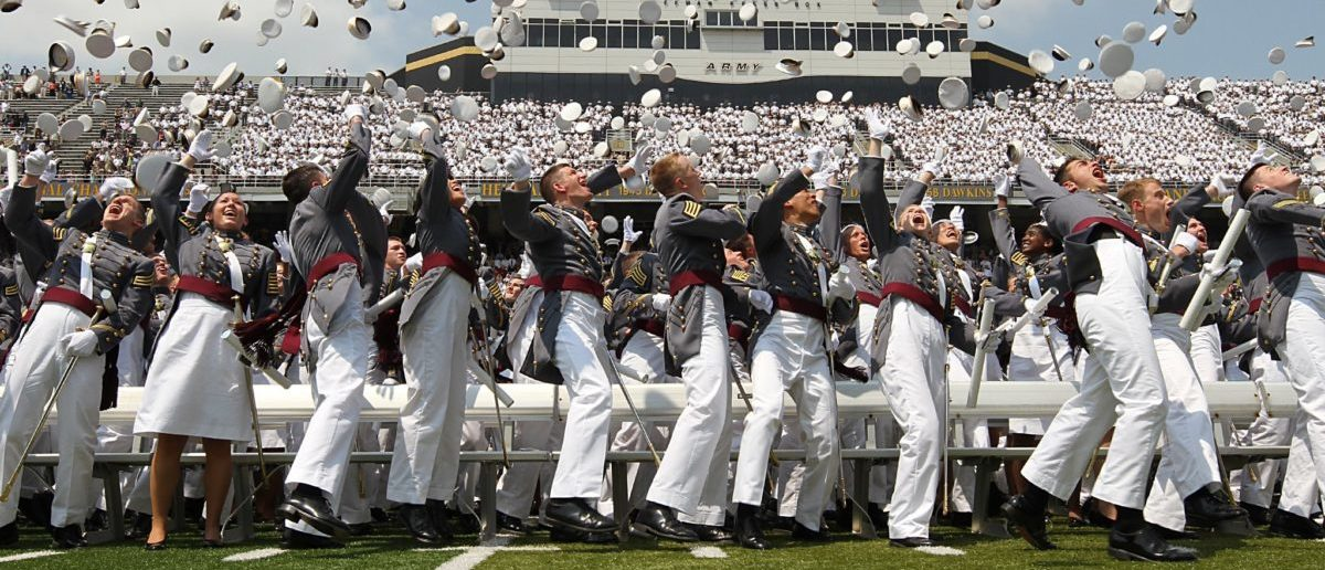 Class of 2012 cadets from the United States Military Academy at West Point toss their hats.  US Army Flickr