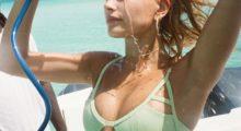 Hailey Baldwin hoses off during a photo shoot  in a lime green bikini. (photo: Instagram)