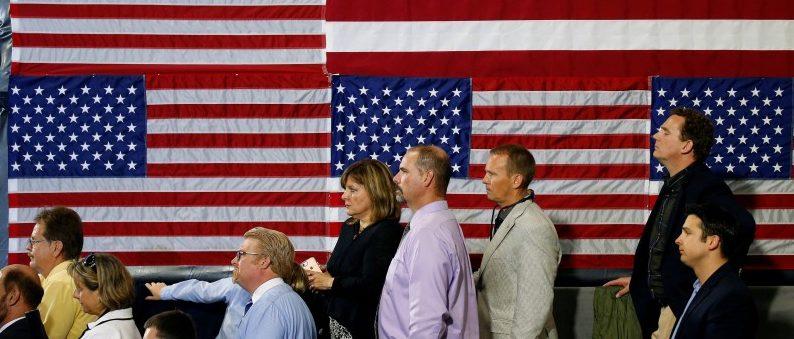 People listen as U.S. President Donald Trump speaks about tax reform in Harrisburg, Pennsylvania, U.S., October 11, 2017. REUTERS/Joshua Roberts