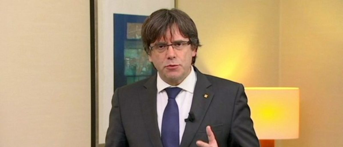 "Sacked Catalan President Carles Puigdemont makes a statement in this still image from video calling for the release of ""the legitimate government of Catalonia"", after a Spanish judge ordered nine Catalan secessionist leaders to be held in custody pending a potential trial over the region's independence push, in Brussels, Belgium, November 2, 2017. TV3 via REUTERS TV"
