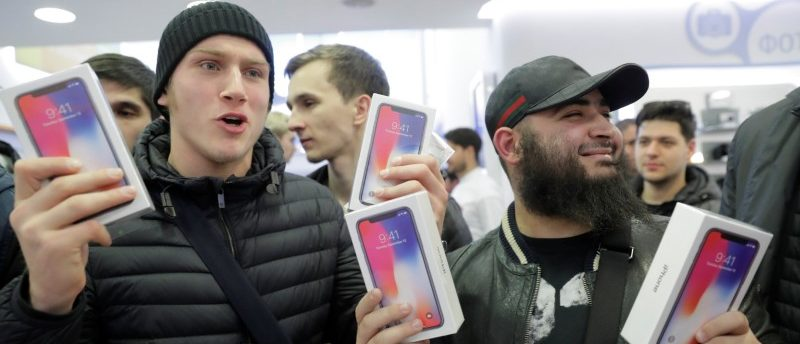 First customers to buy Apple's new iPhone X pose during its global launch at a cell phone store in central Moscow, Russia November 3, 2017. REUTERS/Tatyana Makeyeva