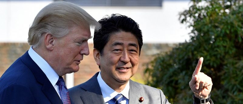 U.S. President Donald Trump (L) is welcomed by Japan's Prime Minister Shinzo Abe upon his arrival at the Kasumigaseki Country Club in Kawagoe, near Tokyo, Japan, November 5, 2017. REUTERS/Frank Robichon/Pool