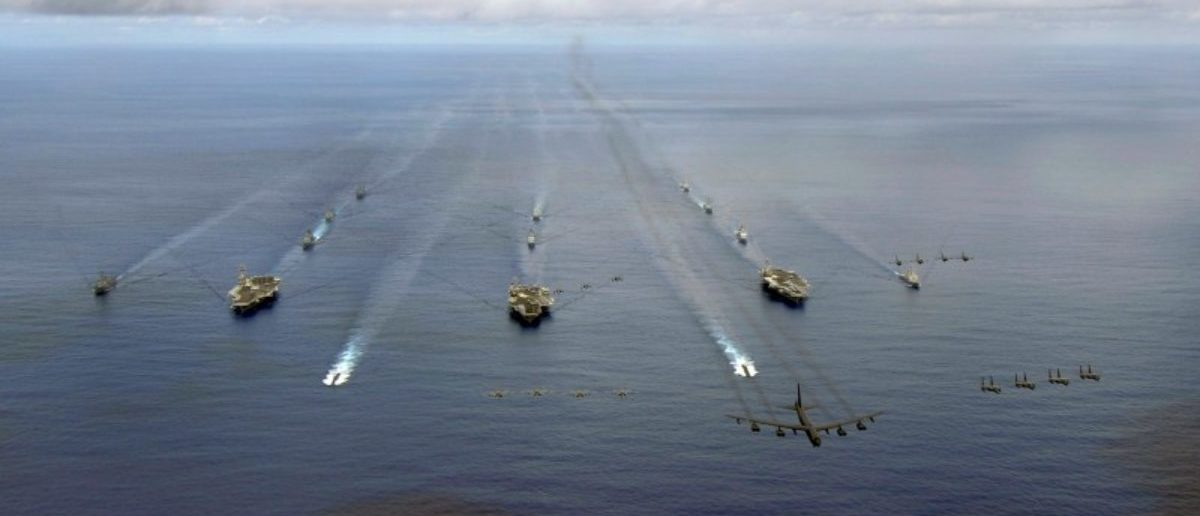 The USS Nimitz, USS Kitty Hawk and USS John C. Stennis Carrier Strike Groups transit in formation during a joint photo exercise during exercise Valiant Shield 2007 in the Pacific Ocean in this August 14, 2007 handout photo. The aerial formation consists of aircraft from the carrier strike groups as well as Air Force aircraft.   Mass Communication Specialist Seaman Stephen W. Rowe/U.S. Navy/Handout via REUTERS