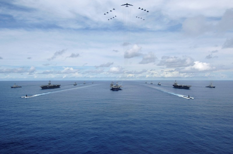 Carrier Strike Groups transit in formation during a photo exercise Seaman Stephen W. Rowe/ REUTERS