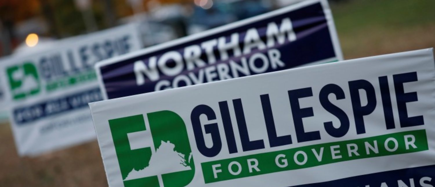 Campaign signs for Ed Gillespie and Ralph Northam are seen on Election Day at Washington Mill Elementary School in Alexandria, Virginia, U.S., November 7, 2017. REUTERS/Aaron P. Bernstein