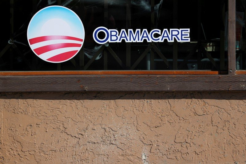 FILE PHOTO: A sign on an insurance store advertises Obamacare in San Ysidro, San Diego, California, U.S., October 26, 2017. REUTERS/Mike Blake/File Photo