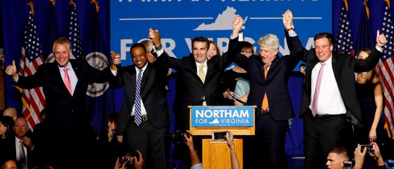 FILE PHOTO: Virginia Governor Elect Ralph Northam (C) celebrates with, left to right, Gov. Terry McAuliffe, Lt. Governor Elect Justin Fairfax, Attorney General Mark Herring and Sen. Mark Warner (D-VA), at his election night rally on the campus of George Mason University in Fairfax, Virginia, November 7, 2017. REUTERS/Aaron P. Bernstein/File Photo