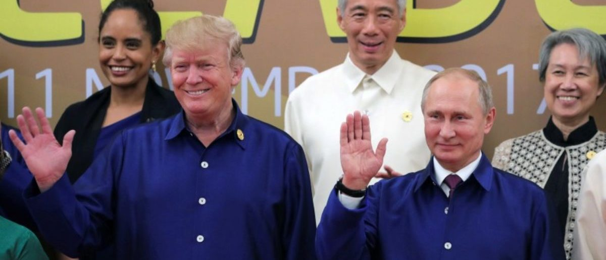 President Trump and Russian President Vladimir Putin take part in a family photo at the APEC summit in Danang, Vietnam. Sputnik/Mikhail Klimentyev/Kremlin via REUTERS