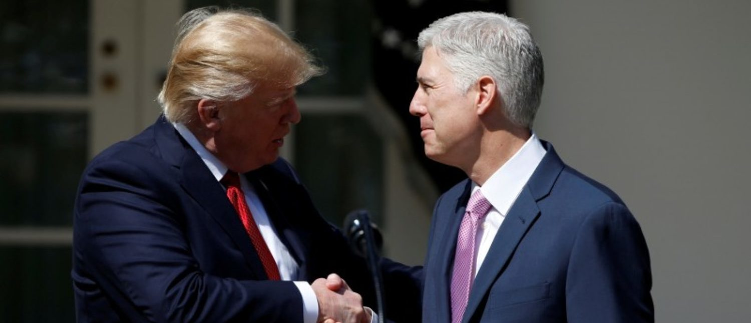 FILE PHOTO: U.S. President Donald Trump shakes hands with Judge Neil Gorsuch after he was sworn in as an Associate Supreme Court in the Rose Garden of the White House in Washington, U.S. on April 10, 2017. REUTERS/Joshua Roberts/File Photo