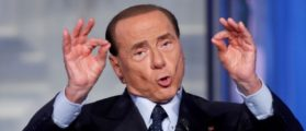 FILE PHOTO : Italy's former Prime Minister Silvio Berlusconi gestures during the television talk show