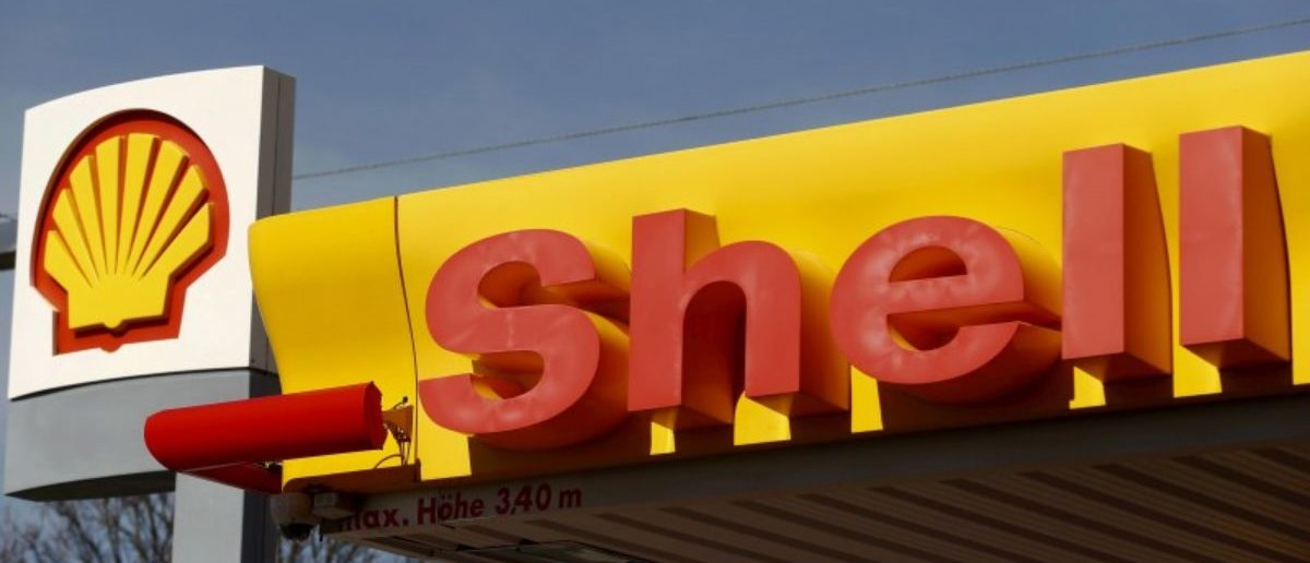 FILE PHOTO: Shell's company logo is pictured at a gas station in Zurich