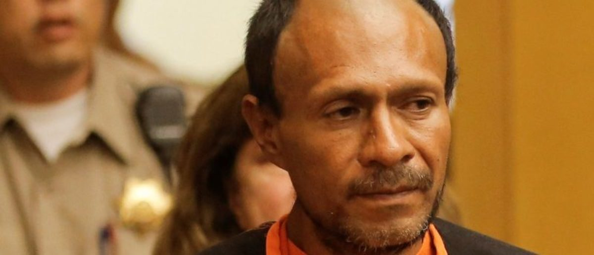 FILE PHOTO: Jose Ines Garcia Zarate, arrested in connection with the July 1, 2015, shooting of Kate Steinle on a pier in San Francisco is led into the Hall of Justice for his arraignment in San Francisco, on July 7, 2015. REUTERS/Michael Macor/Pool/File Photo
