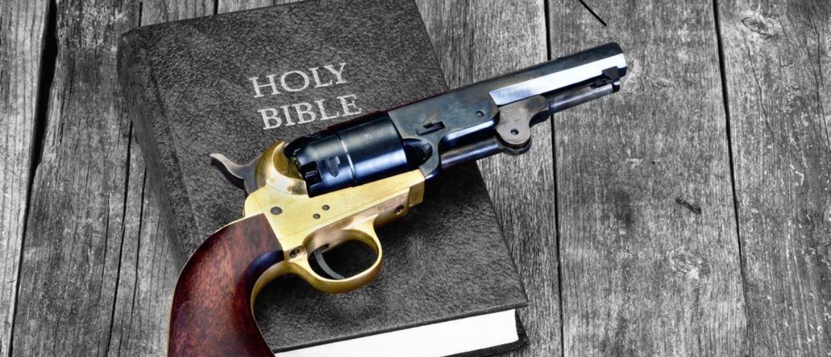 A Gun And The Bible (Shutterstock/W. Scott McGill)