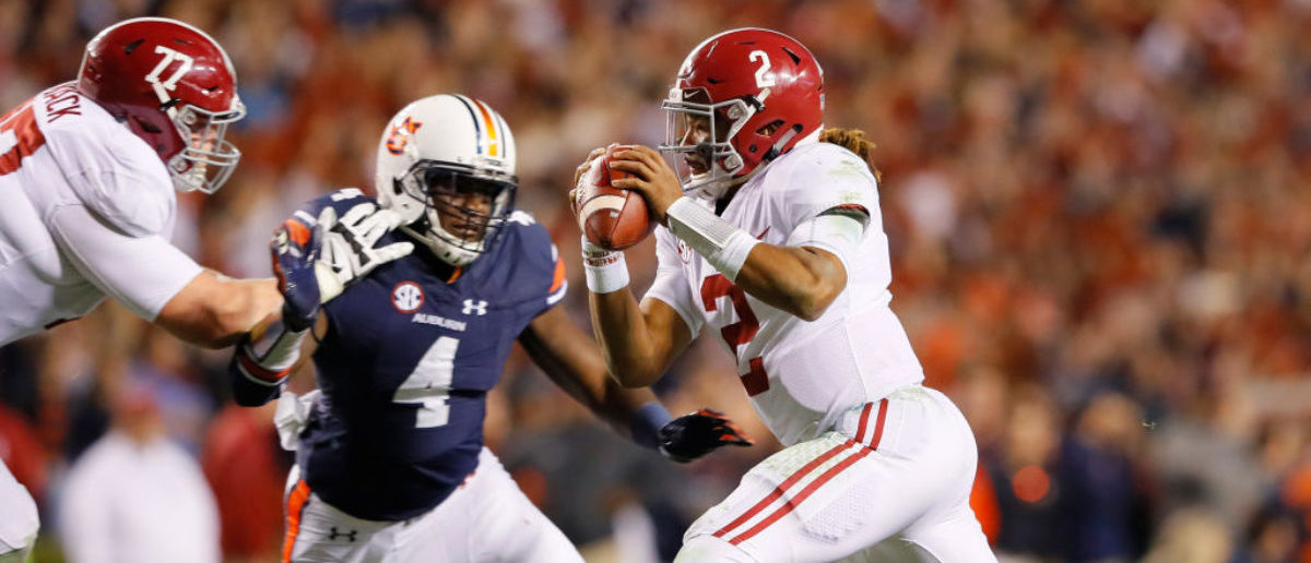 AUBURN, AL - NOVEMBER 25: Jalen Hurts #2 of the Alabama Crimson Tide avoids the pass rush of the Auburn Tigers during the fourth quarter at Jordan Hare Stadium on November 25, 2017 in Auburn, Alabama. (Photo by Kevin C. Cox/Getty Images)