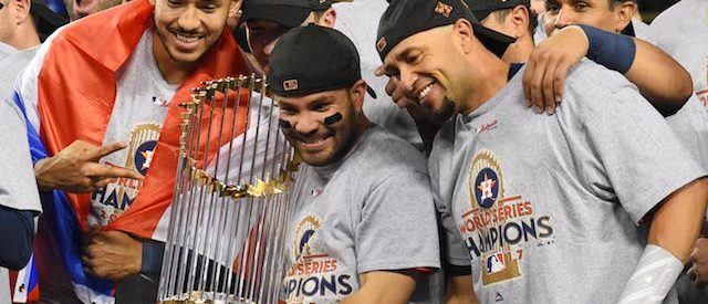 Nov 1, 2017; Los Angeles, CA, USA; Houston Astros second baseman Jose Altuve (center) celebrates with teammates with the Commissioner's Trophy after defeating the Los Angeles Dodgers in game seven of the 2017 World Series at Dodger Stadium. Mandatory Credit: Jayne Kamin-Oncea-USA TODAY Sports Reuters