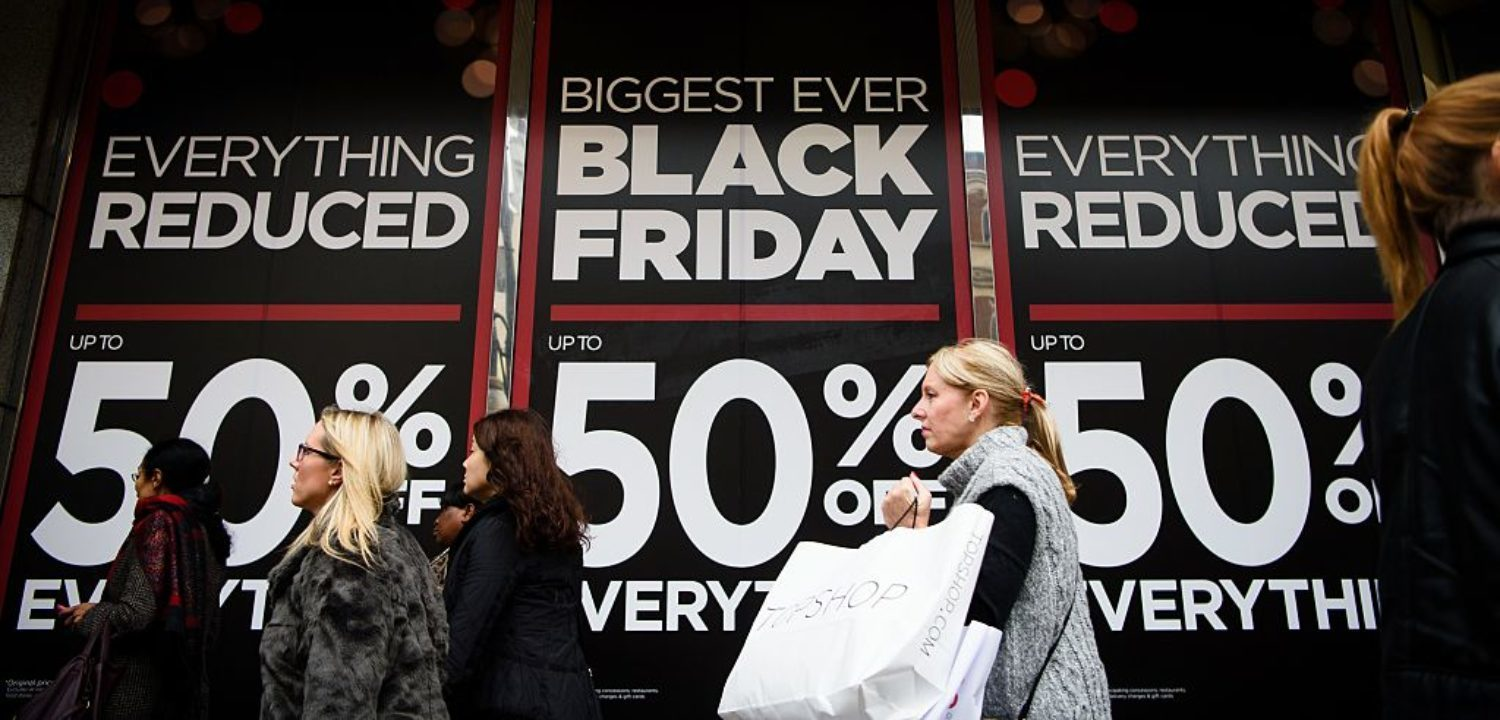 "Retail stores display ""Black Friday"" advertisements and banners on Oxford Street in central London, as the annual retail event takes place on November 27, 2015. Black Friday, is a sales offer originating from the US where retailers slash prices on the day after the Thanksgiving holiday. Early indications suggest that online sales have faired better than retail stores. (Photo: LEON NEAL/AFP/Getty Images)"