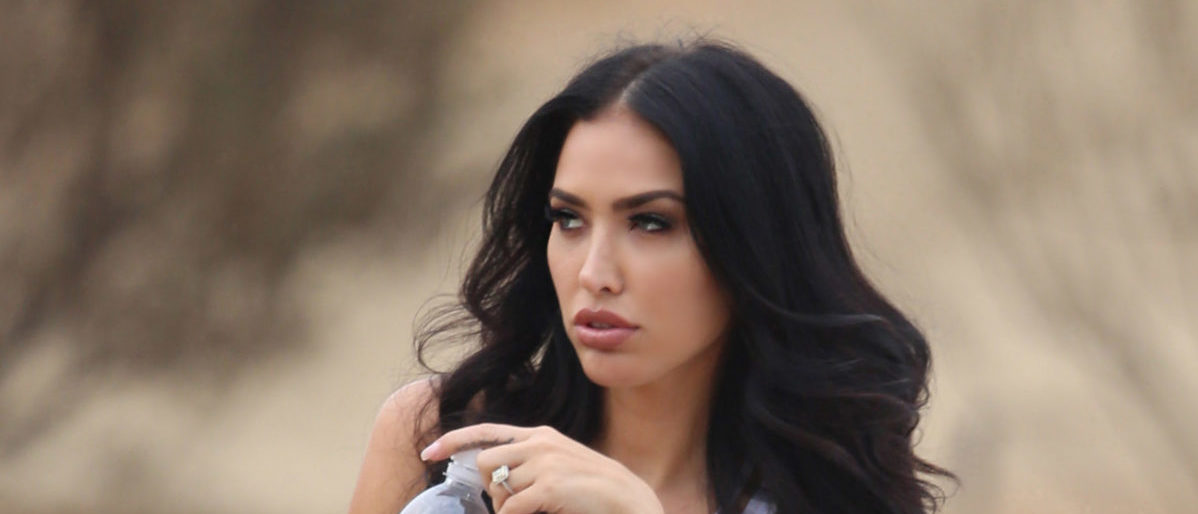 Johnny Manziel's Fiancee Bre Tiesi gets an adreline rush as she cruises in a DCD Customed Jeep while doing a Photoshoot for 138 Water in the Coachella Valley, CA. (Credit: Splash News)