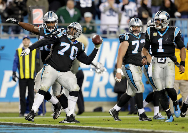 CHARLOTTE, NC - NOVEMBER 13: Trai Turner #70 of the Carolina Panthers throws the ball into the stands after his team scores a touchdown against the Miami Dolphins during their game at Bank of America Stadium on November 13, 2017 in Charlotte, North Carolina. (Photo by Streeter Lecka/Getty Images)