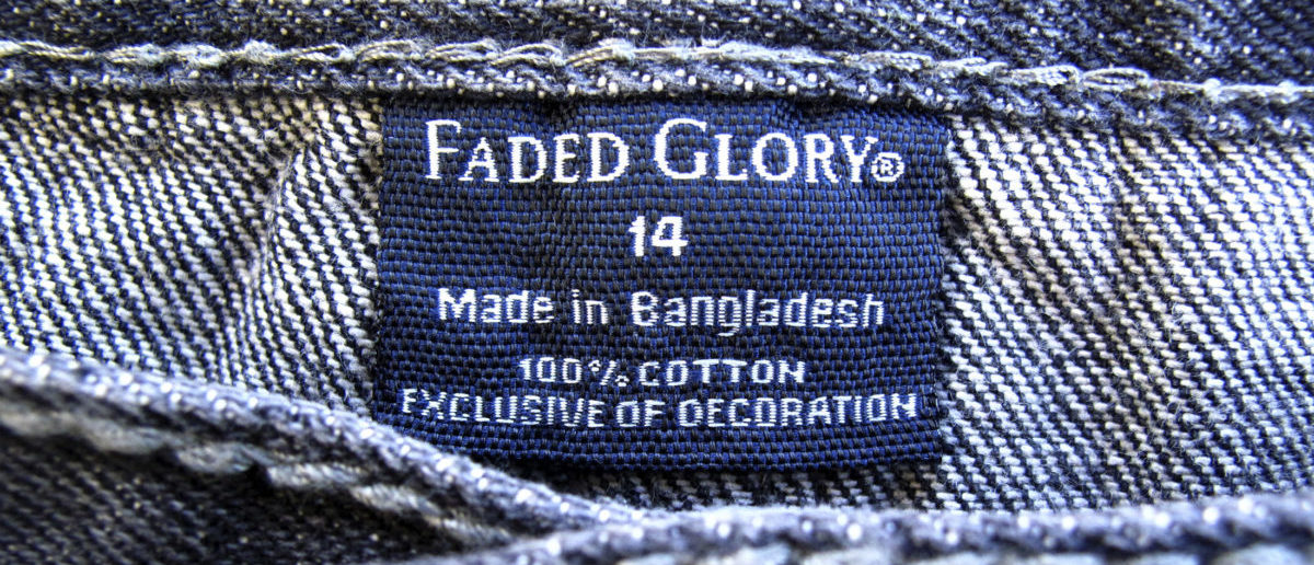 The clothing tag on a pair of jeans by Wal-Mart's brand Faded Glory, which is made in Bangladesh, is shown after purchase from a Walmart store in Encinitas, California, May 14, 2013. Wal-Mart Stores Inc said on Tuesday that it would conduct in-depth safety inspections at all 279 Bangladesh factories with which it works and publicly release the names and inspection information, as pressure mounts on retailers to ensure worker safety after April's deadly building collapse. REUTERS/Mike Blake (UNITED STATES - Tags: BUSINESS EMPLOYMENT) - GM1E95F0GAA01