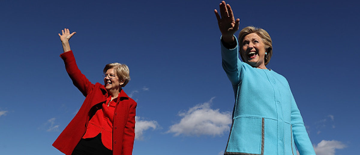 MANCHESTER, NH - OCTOBER 24: Democratic presidential nominee former Secretary of State Hillary Clinton (R) and U.S. Sen. Elizabeth Warren (D-MA) greet supporters during a campaign rally at Saint Anselm College on October 24, 2016 in Manchester, New Hampshire. With just over two weeks to go until the election, Hillary Clinton is campaigning in New Hampshire. (Photo by Justin Sullivan/Getty Images)
