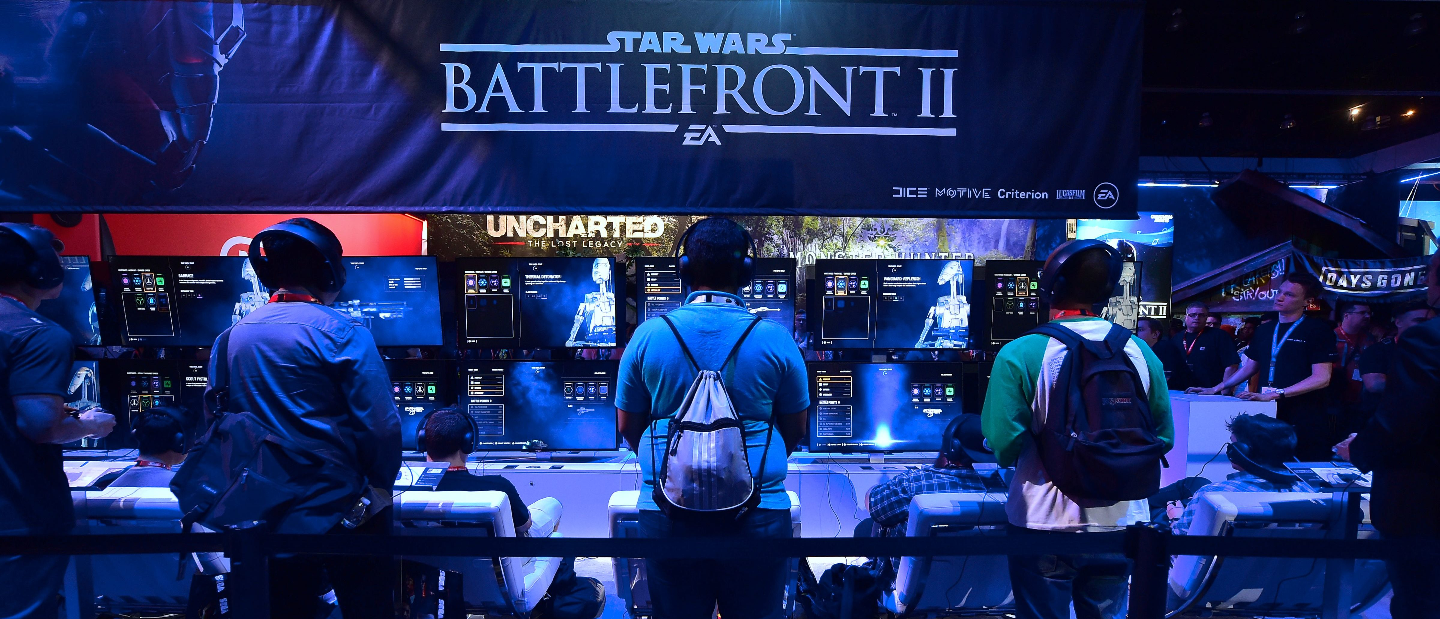 """Gaming fans play """"Star Wars Battlefront II"""" from EA Sports at the Los Angeles Convention Center on day one of E3 2017, the three day Electronic Entertainment Expo, one of the biggest events in the gaming industry calendar, on June 13, 2017 in Los Angeles, California. / AFP PHOTO / FREDERIC J. BROWN (Photo credit should read FREDERIC J. BROWN/AFP/Getty Images)"""