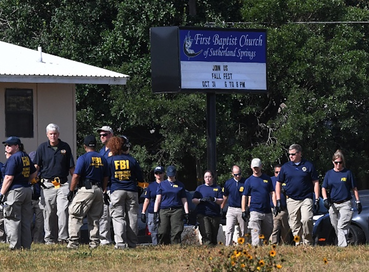 FBI agents search for clues at the entrance to the First Baptist Church, after a mass shooting that killed 26 people in Sutherland Springs, Texas on November 6, 2017. A gunman wearing all black armed with an assault rifle opened fire on a small-town Texas church during Sunday morning services, killing 26 people and wounding 20 more in the last mass shooting to shock the United States. / AFP PHOTO / Mark RALSTON        (Photo credit should read MARK RALSTON/AFP/Getty Images)