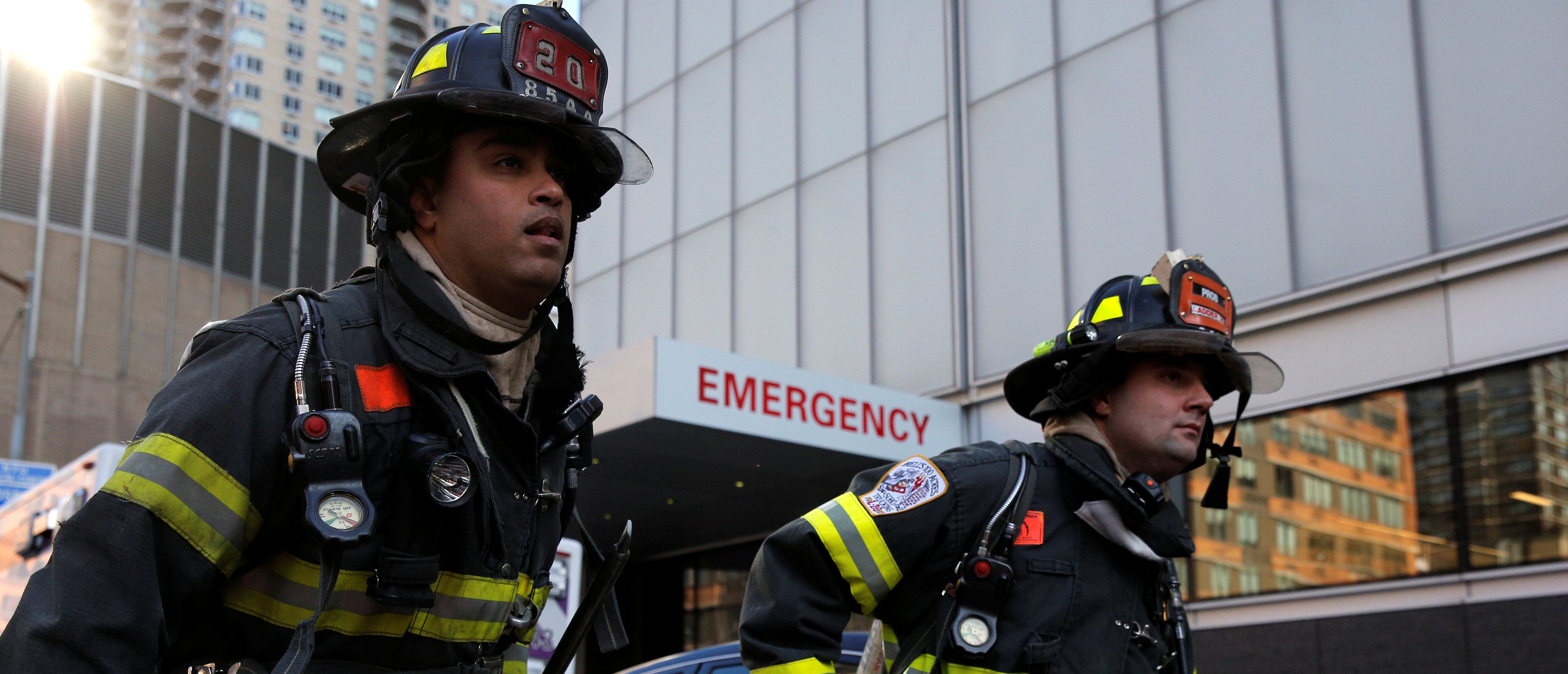 New York City firefighters (FDNY) at the scene of a fire at NYU Medical Center in Manhattan, New York City, U.S., December 14, 2016. REUTERS/Brendan McDermid