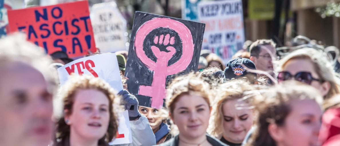 TUCSON, AZ - JANUARY 21: Selective focus view of woman holding pink female with fist sign at the Women's March on Washington January 21, 2017 in Tucson, AZ, USA. (Photo: Shutterstock/ CREATISTA)