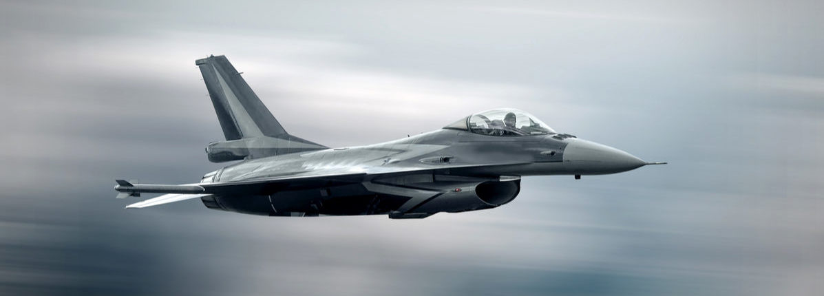 Military airplane at flying on the speed Shutterstock/ Andrey Yurlov